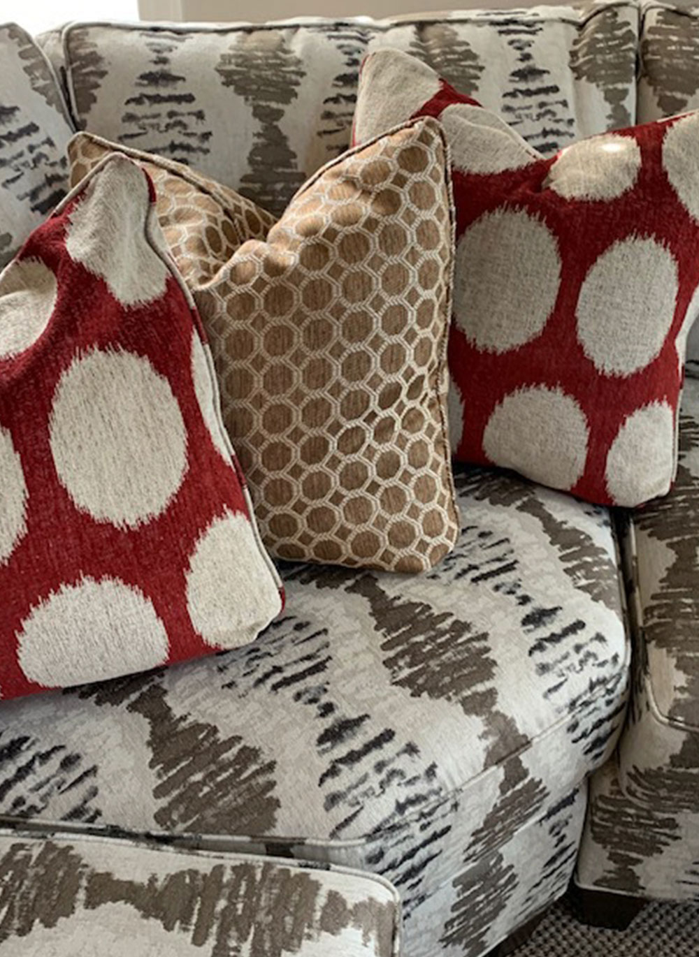 Details of patterned sofa and pillows