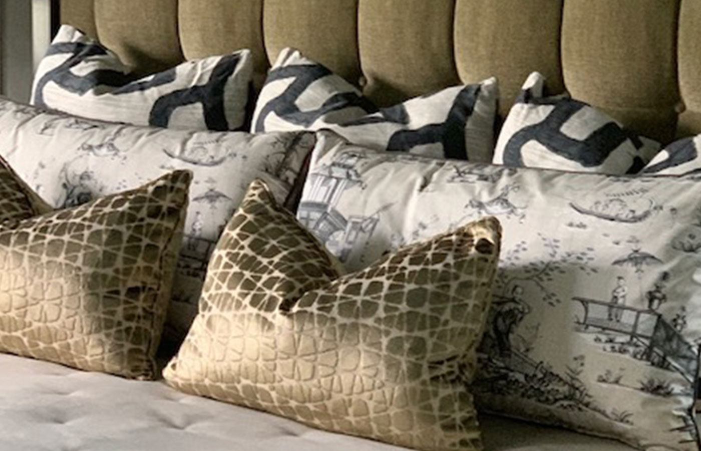 decorative pillows on modern bedding