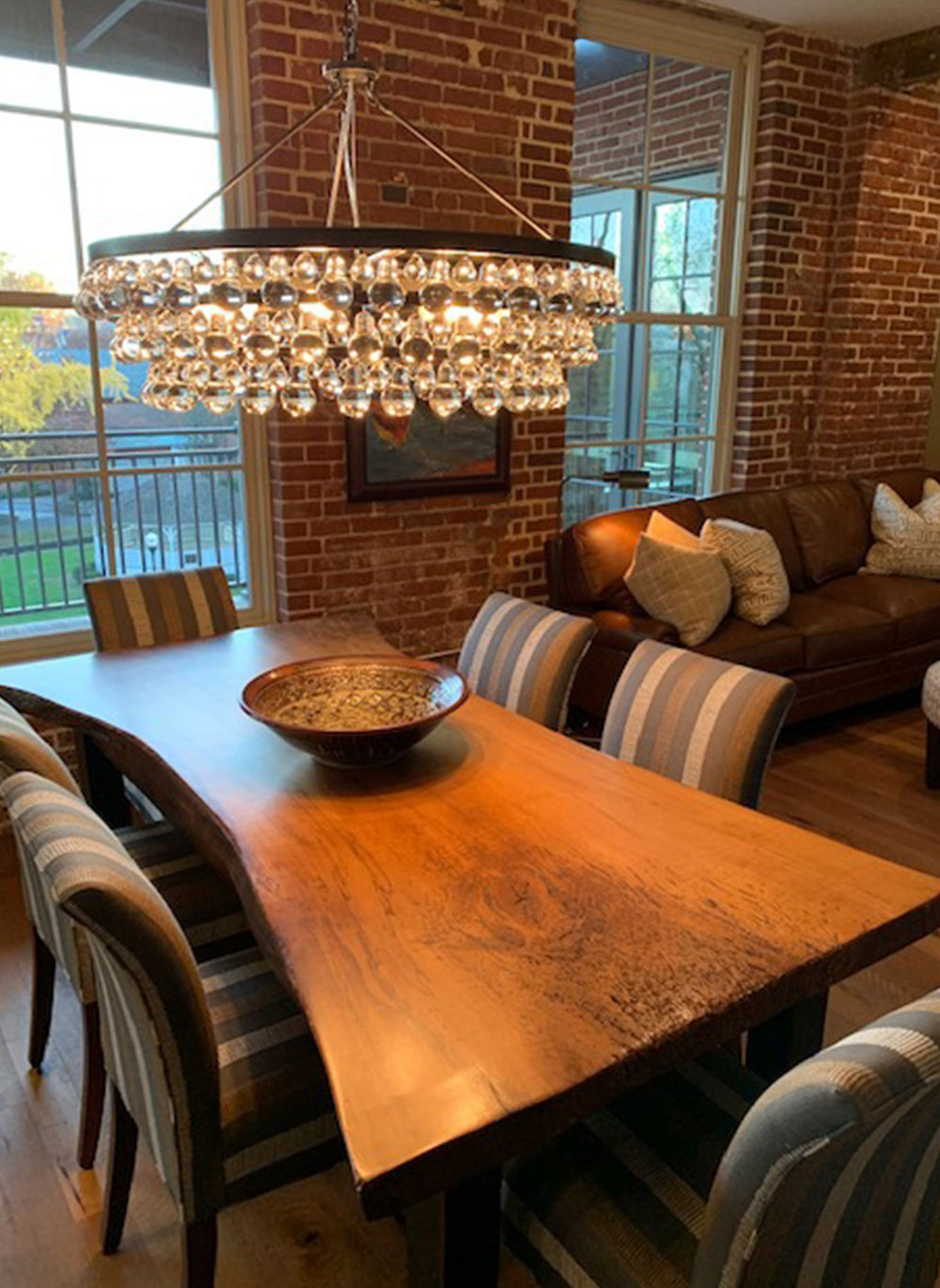 crystal chandelier over custom crafted wood dining room table