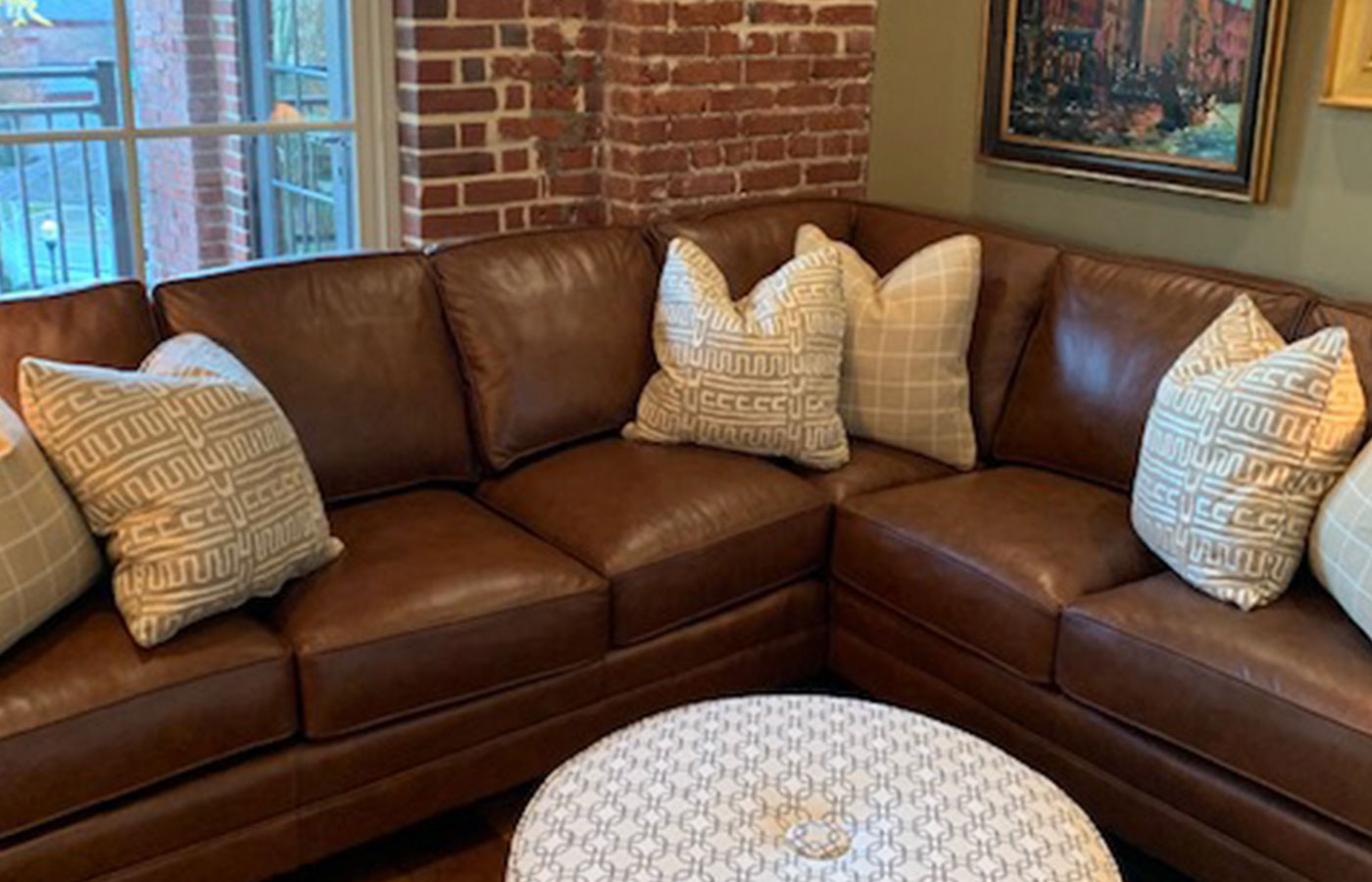 leather sectional with modern throw pillows and settee